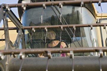 Women farmer driving a combine harvester France