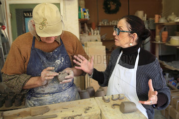 Potter craftsmen at work in their workshop  Martine Gilles and Jaap Wieman  Brantes village  Provence  France