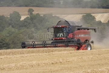 Combine harvester in a field Cotswold the United Kingdom