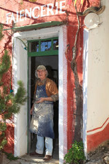 Potter in front of the door of his studio  Martine Gilles and Jaap Wieman  Village of Brantes  Provence  France