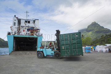 Loading a container in Bora Bora on the Cargo Container ship Hawaiki nui connecting Bora Bora to Tahiti  Society Islands  Leeward Islands  French Polynesia