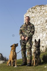 Policeman and dog specialized in track and defense