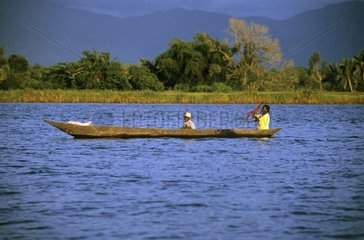 Fishermen in a dugout Antongil Bay Madagascar