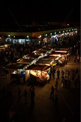 The Jamaa El Fna place at night and market Marrakech Morocco