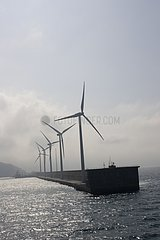 Giant wind turbines on breakwater at Bilbao harbour Spain