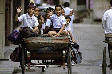 Schoolchildren in rickshaw Amritsar Punjab India