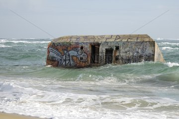 Blockhaus partially submerged by the tide Atlantic