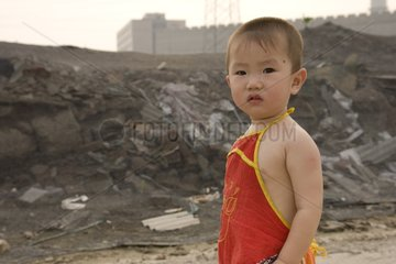 Child to a landfill on the outskirts of Beijing China