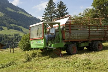 Mechanized haying in mountain area Switzerland