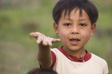 Portrait of Boy reaching out to beg Burma