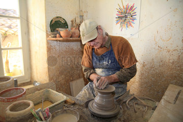 Potter working on a clay piece  Martine Gilles and Jaap Wieman  Village of Brantes  Provence  France
