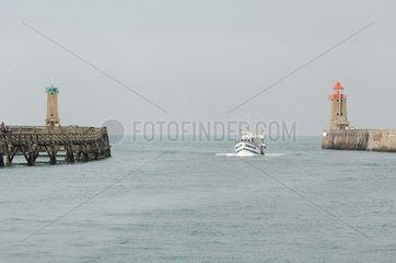 Fishing boat returning to port Fécamp France