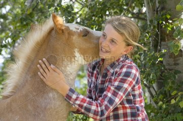 Young girl and Quarter Horse cross Pinto - Canada Rockies