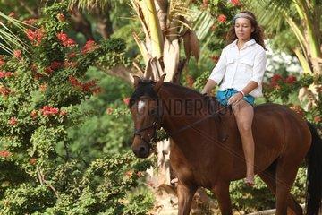 Young girl riding bareback - Senegal