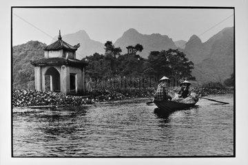 Pirogue navigating on the river Salongane Vietnam
