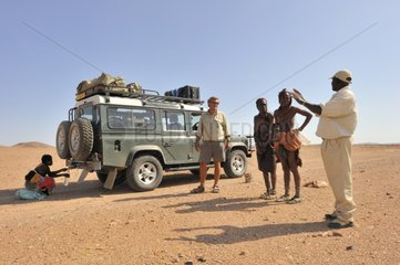 Meeting between the Himba women and guides in Namibia