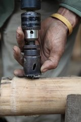 Drilling a Bamboo during the manufacture of a bed Laos