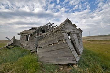 Wind and farm in ruins Montana USA