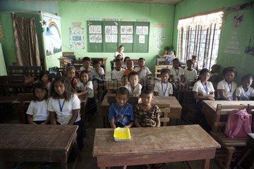 Schoolchildren in class Santa Jiuliana Luzon Philippines