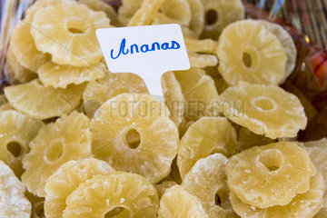 Candied pineapple slices on a market stall  summer  Provence  France