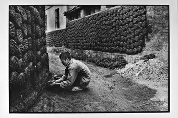 Man making small charcoal brick Vietnam