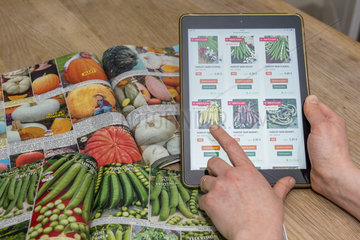 Order vegetable seed seeds using a digital tablet.