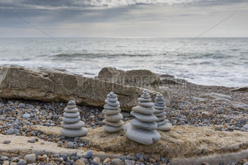 Realization of cairns on a beach of the Opal Coast  spring  France