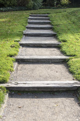 Steps made in a railway crossing in an alley  autumn  Somme  France