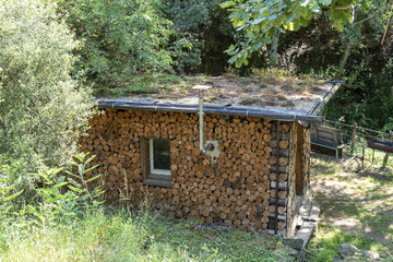 Cabin with green roof and wooden log siding  summer  Ardèche  France