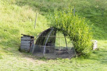Rabbit hutch in a garden  summer  Moselle  France