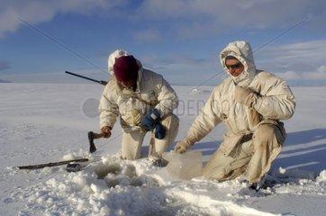 Adventurer seeking a water point under snow Spitzberg
