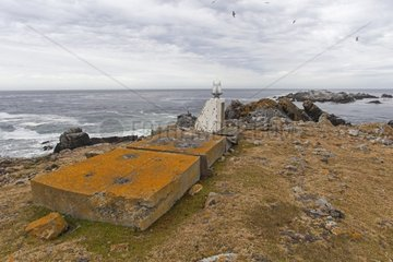 Small lighthouse and rocks with lichen - Falkland Islands