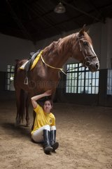 Woman making a exercise in trust with a horse