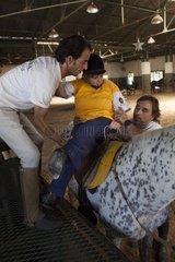 Men helping a paraplegic woman to ride