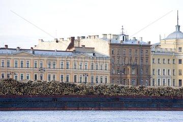 Loading of wood cut in the taiga in Saint Petersburg Russia