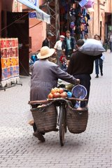 Man pushing its bicycle in the lanes of the Medina Marrakech