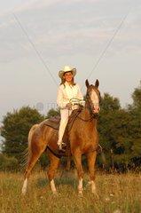 Western riding woman on Horse Appaloosa - France