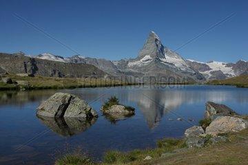 Reflection of the Matterhorn on a mountain lake - Swiss Alps
