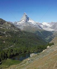 Matterhorn above a mountain lake - Swiss Alps