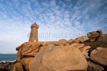 Lighthouse and rock on the coast of pink granite - Brittany France