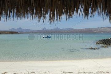 Sand beach and Lagoon Isla Coronado seen of a hut