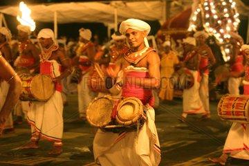 Dancers and musicians in Perahera of Kandy Sri Lanka