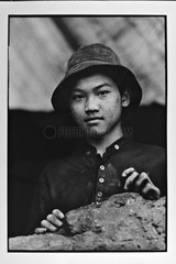 Portrait of a coal miner at the port in Hanoi Vietnam