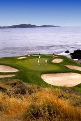 The famous Hole number 7 at the expensive Pebble Beach Golf Course in Pebble Beach California one of the most famous golf courses in the world