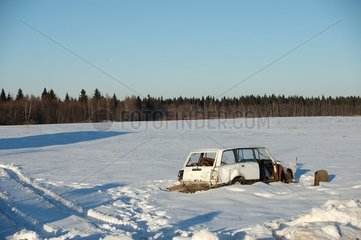 Carcass of car in the countryside of the lake Ladoga Russia