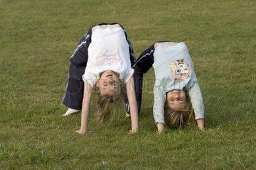 Young girls practising gymnastics in the Forest of Dean