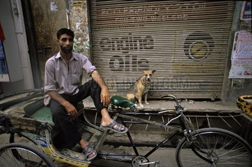 Dog and man on a scooter Vârânaçî India