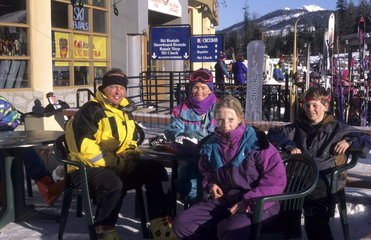Ski family dressed for skiing at famous ski town of Whistler in British Columbia Canada