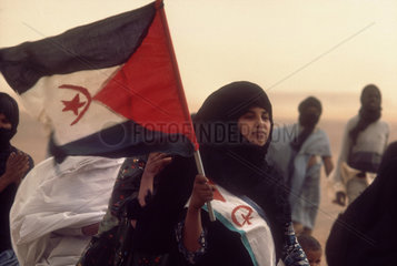WESTERN SAHARA : South of Tindouf. Polisario. Political manifestation in the middle of a sandstorm.