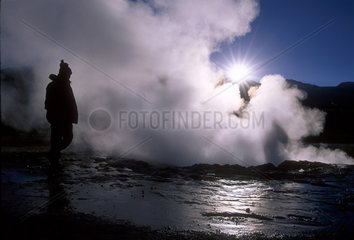 Travel  ecotourism. Geothermal Feature - Geiser - Atacama Desert  Chile. Ecological tourism in South America.